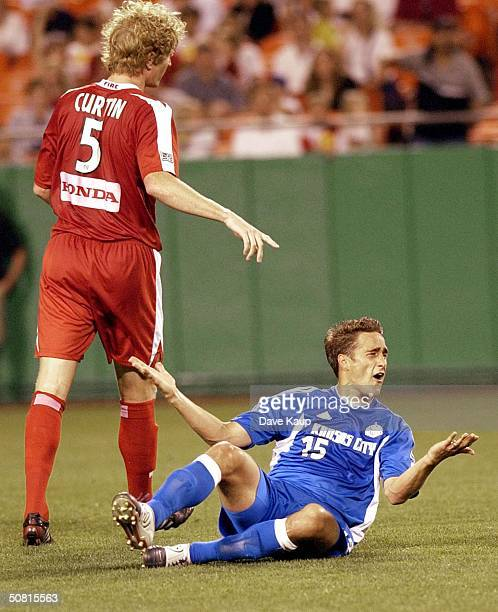 Forward Josh Wolff of the Kansas City Wizards looks for the call from the referee during a game against the Chicago Fire May 8 2004 at Arrowhead...
