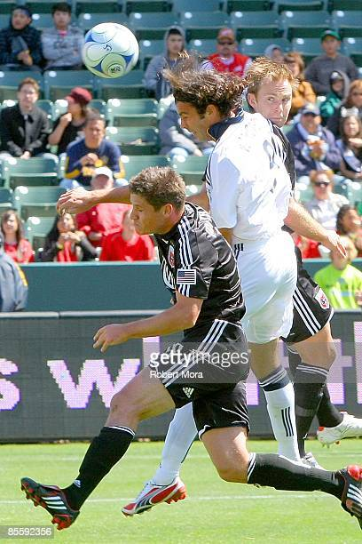 Forward Jovan Kirovski of the Los Angeles Galaxy attempts a header over Devon McTavish DC United during the MLS game at Home Depot Center on March 22...