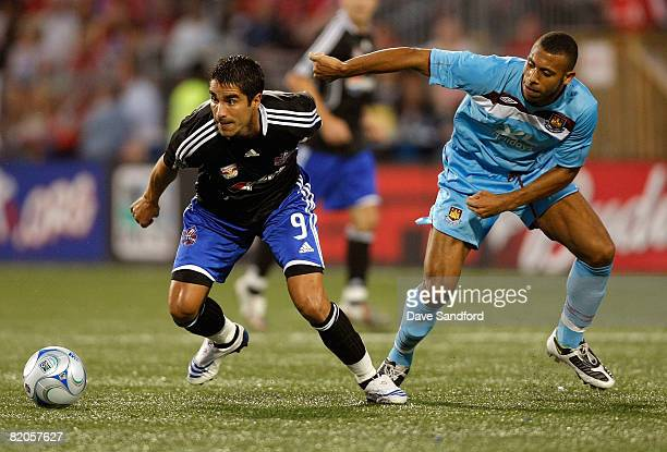 Forward Juan Pablo Angel of New York Red Bulls keeps the ball from defender Anton Ferdinand during the 2008 Pepsi MLS All Star Game between the MLS...