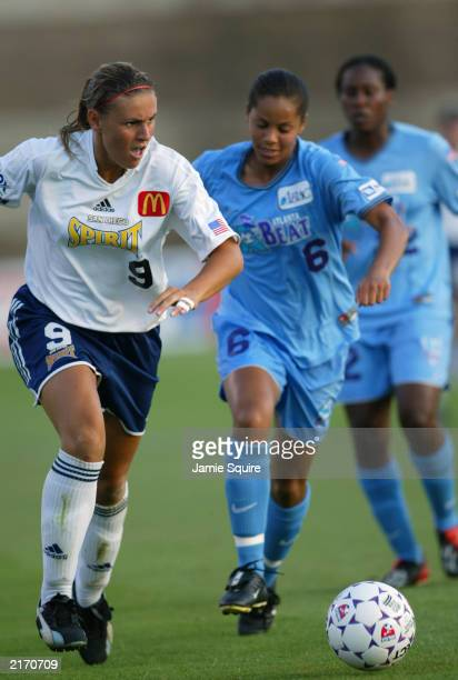 Forward Julie Fleeting of the Diego Spirit dribbles the ball against the Atlanta Beat during the WUSA game at Herndon Stadium on July 9 2003 in...