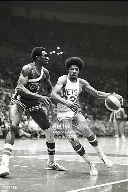 Forward Julius Erving of the New York Nets drives against forward Gerald Govan of the Utah Stars during an American Basketball Association game at...