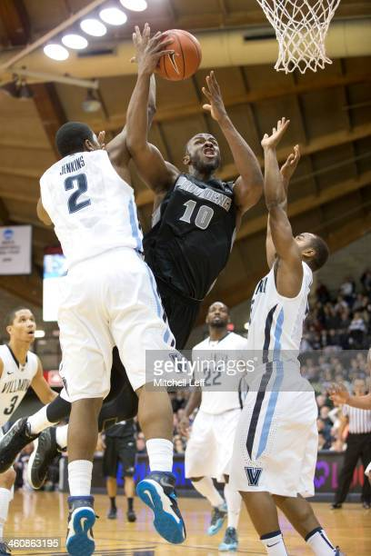 Forward Kadeem Batts of the Providence Friars attempts a layup against forward Kris Jenkins of the Villanova Wildcats on January 5 2014 at the...