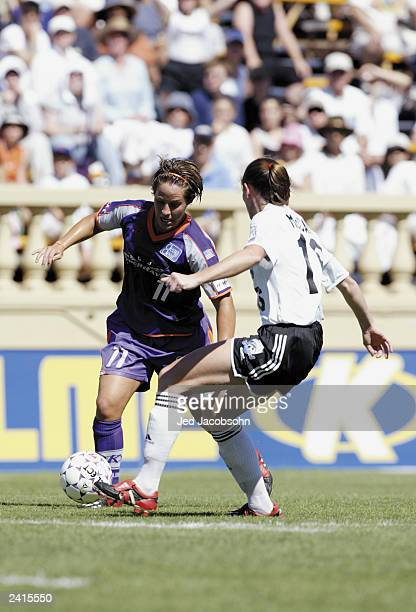 Forward Katie Barnes of the San Jose Cyberrays moves the ball against defender Christine McCann of the Boston Breakers during the WUSA game at...