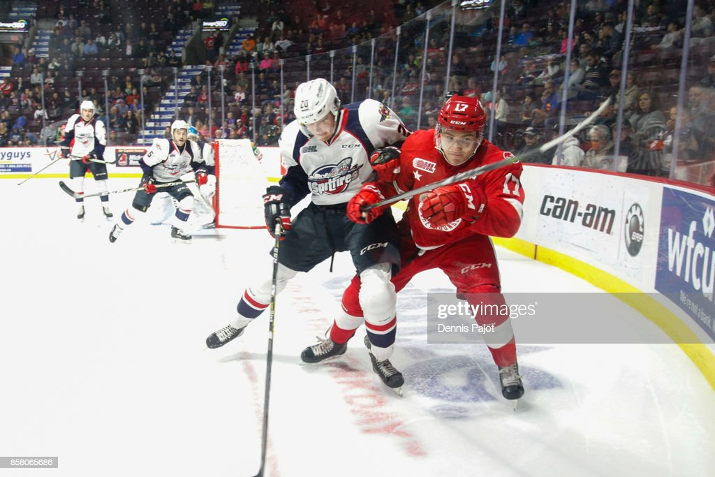 Forward Keeghan Howdeshell #17 of the Sault Ste. Marie Greyhounds battles against forward Luke Kutkevicius #20 of the Windsor Spitfires on October 5, 2017 at the WFCU Centre in Windsor, Ontario, Canada.