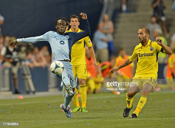 Forward Kei Kamara of Sporting Kansas City makes a play on the ball against midfielder Federico Higuain of the Columbus Crew during the second half...