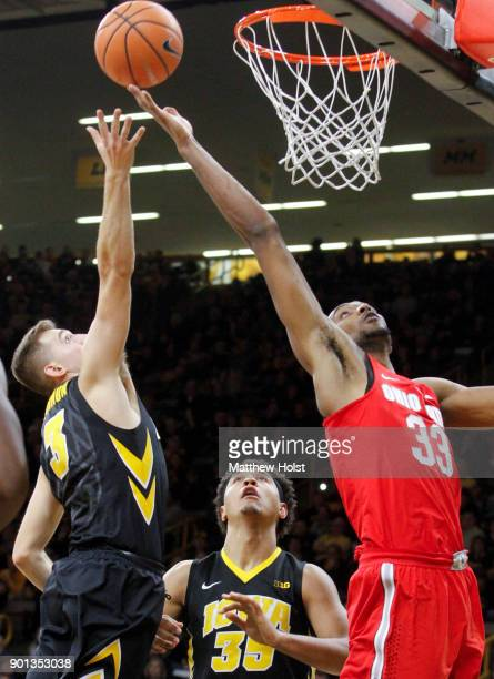 Forward Keita BatesDiop of the Ohio State Buckeyes battles for a rebound in the second half against guard Jordan Bohannon and forward Cordell Pemsl...