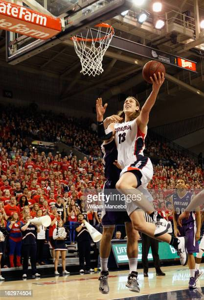 Forward Kelly Olynyk of the Gonzaga Bulldogs goes to the hoop against the Portland Pilots during the first half of the game at McCarthey Athletic...