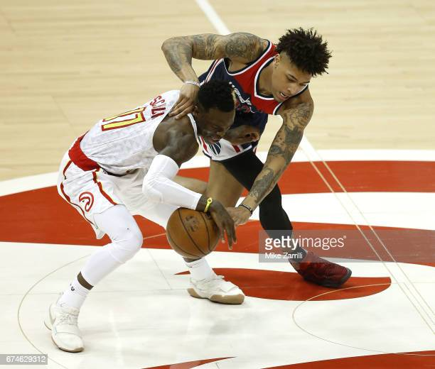 Forward Kelly Oubre Jr #12 of the Washington Wizards strips the ball from guard Dennis Schroder of the Atlanta Hawks during Game Six of the Eastern...