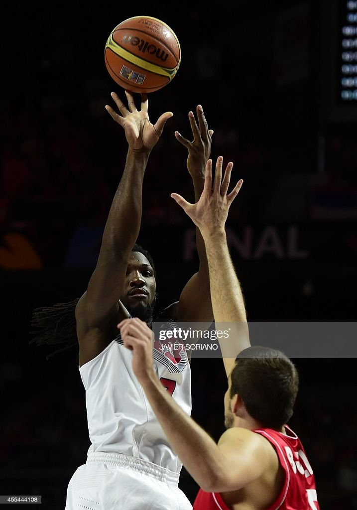 US forward Kenneth Faried (L) vies with Serbia's forward Nemanja Bjelica during the 2014 FIBA World basketball championships final match USA vs Serbia at the Palacio de los Deportes in Madrid on September 14, 2014.