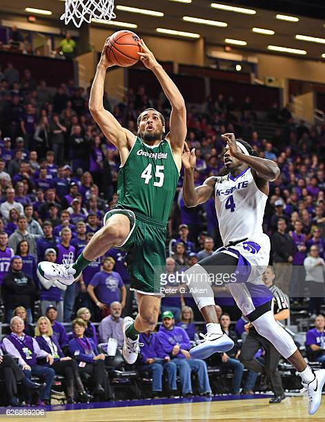 Forward Kenneth Lowe of the Wisconsin-Green Bay Phoenix drives to the basket against forward D.J. Johnson of the Kansas State Wildcats during the...
