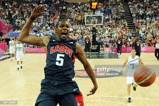 US forward Kevin Durant jumps for the ball during the London 2012 Olympic Games men's semifinal basketball game between Argentina and the USA at the...