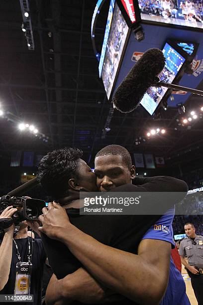 Forward Kevin Durant of the Oklahoma City Thunder hugs his mother Wanda Pratt after a 90105 win against the Memphis Grizzlies in Game Seven of the...