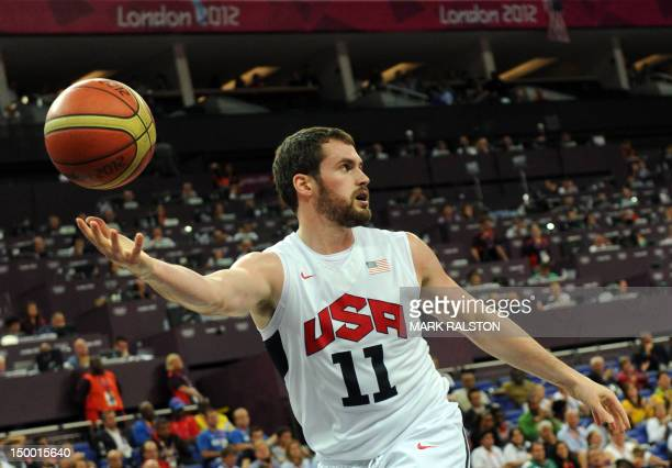 Forward Kevin Love controls the ball during his team's London 2012 Olympic Games men's quarterfinal basketball match against Australia in London on...