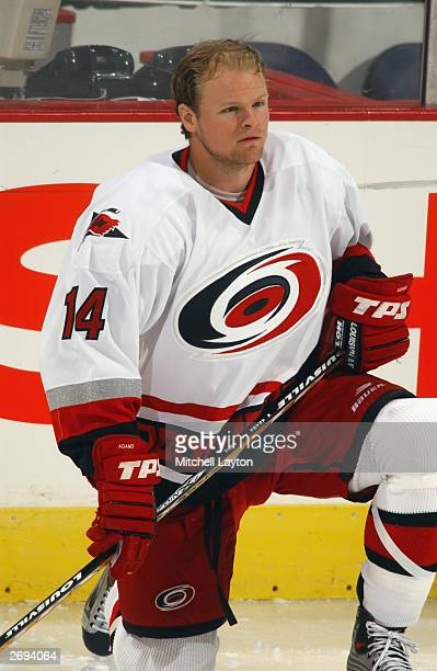 Forward Kevyn Adams of the Carolina Hurricanes kneels on the ice during the NHL game against the Washington Capitals at the MCI Center on October 3...