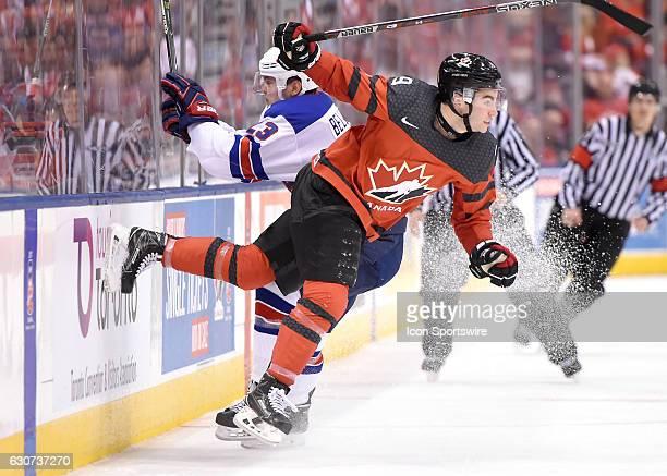 USA forward Kieffer Bellows knocks down Canada forward Dillon Dube during the World Junior Hockey Championships on December 31 at the Air Canada...