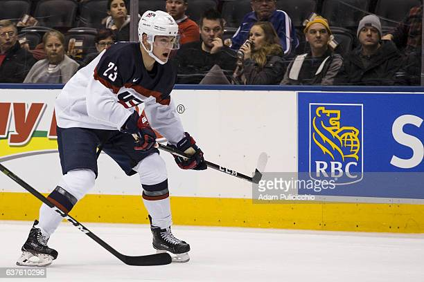 Forward Kieffer Bellows of Team United States anticipates the play in the Team Slovakia defensive zone in a preliminary round Group B game during the...