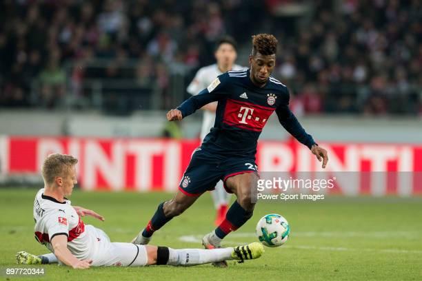 Forward Kingsley Coman of FC Bayern Muenchen is tackled by Timo Baumgartl VfB Stuttgart during the Bundesliga match between VfB Stuttgart and FC...