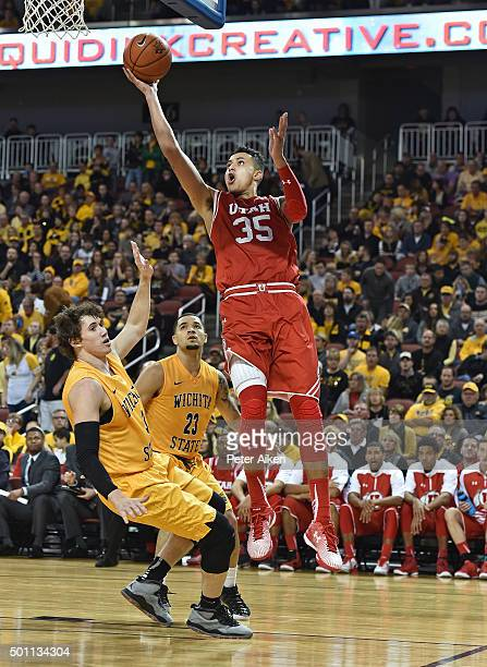 Forward Kyle Kuzma of the Utah Utes drives to the basket against guard Evan Wessel of the Wichita State Shockers during the second half on December...