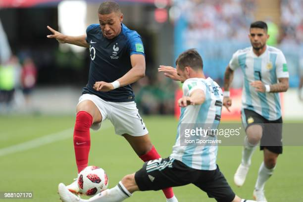 Forward Kylian Mbappe of France National team in action with defender Nicolas Tagliafico of Argetina National team during the round of 16 match...