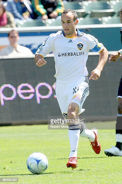 Forward Landon Donovan of the Los Angeles Galaxy attacks the defense of DC United during the MLS game at Home Depot Center on March 22 2009 in Carson...