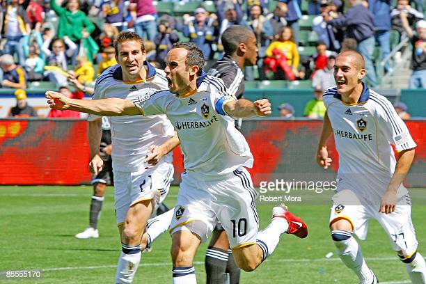 Forward Landon Donovan of the Los Angeles Galaxy celebrates after scoring his second goal of the season against DC United during their MLS game at...