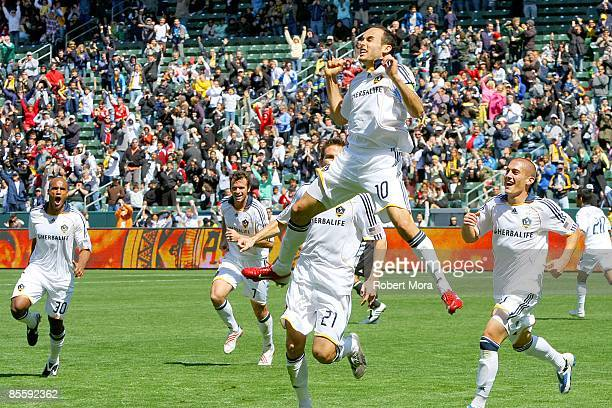 Forward Landon Donovan of the Los Angeles Galaxy celebrates scoring the game tying goal against DC United during the MLS game at Home Depot Center on...