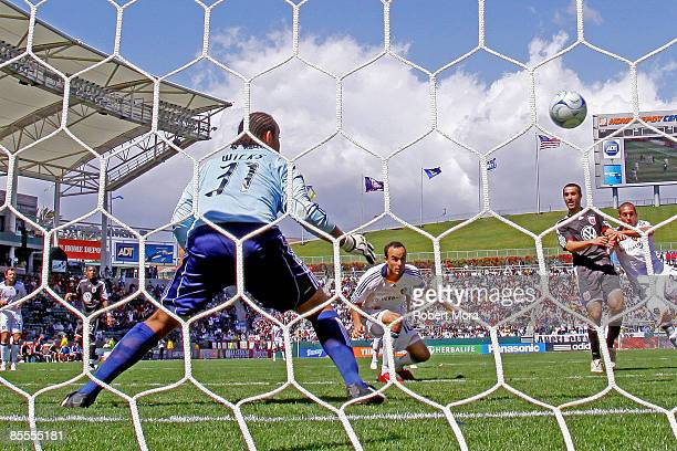 Forward Landon Donovan of the Los Angeles Galaxy puts the game tying goal past Josh Wicks of DC United during their MLS game at Home Depot Center on...