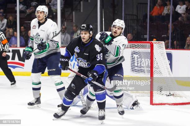 Forward Landon Quinney of the Saint John Sea Dogs battles in front of the net against forward Donovan Neuls of the Seattle Thunderbirds on May 23...