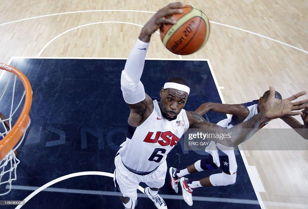 US forward LeBron James (C) grabs a rebo : News Photo