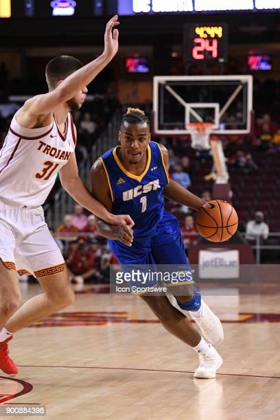UCSB forward Leland King II drives past USC forward Nick Rakocevic during a college basketball game between the UC Santa Barbara Gauchos and the USC...