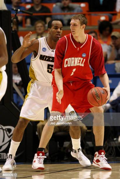 Forward Leo Lyons of the Missouri Tigers defends against center Jeff Foote of the Cornell Big Red in the first round of the NCAA Division I Men's...