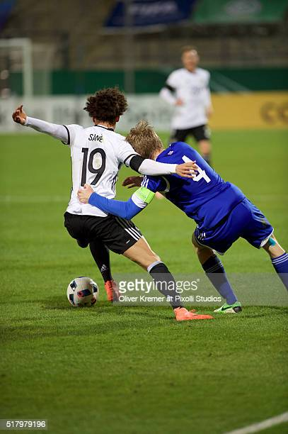 Forward Leroy Sané of Germany and Andrias H Eriksen of Faeroer Islands fighting for the ball at Frankfurter VolksbankStadion during the international...