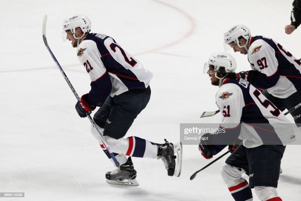 Forward Logan Brown #21 of the Windsor Spitfires celebrates his first-period goal against goaltender Carl Stankowski #1 of the Seattle Thunderbirds on May 21, 2017 during Game 3 of the Mastercard Memorial Cup at the WFCU Centre in Windsor, Ontario, Canada.