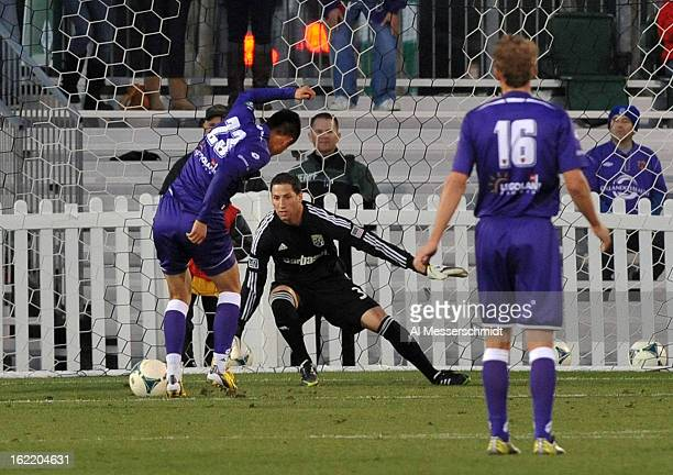 Forward Long Tan of Orlando City shoots on goalie Andy Gruenebaum of the Columbus Crew February 16 2013 in the third round of the Disney Pro Soccer...