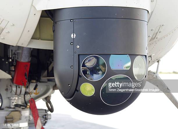 A Forward Looking Infrared (FLIR) camera, mounted on an EH101 utility helicopter.