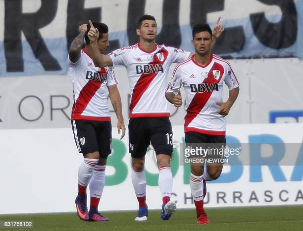 Forward Lucas Alario of Argentine club River Plate celebrates alongside teammates teammates Gonzalo Martinez and Sebastian Driussi after scoring a...