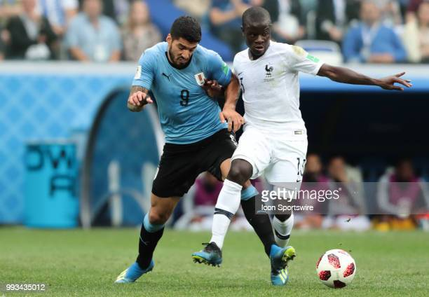forward Luis Suarez of Uruguay in action with midfielder N'Golo Kante of France during the QuarterFinal match between Uruguay and France in the 2018...