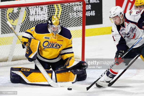 Forward Luke Boka of the Windsor Spitfires deflects the puck against goaltender Daniel Murphy of the Erie Otters on December 13 2018 at the WFCU...