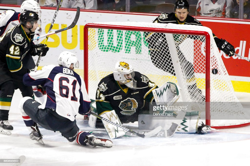 Forward Luke Boka #61 of the Windsor Spitfires fires the puck against goaltender Tyler Johnson #34 of the London Knights on October 12, 2017 at the WFCU Centre in Windsor, Ontario, Canada.