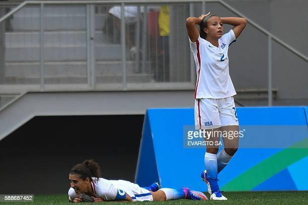TOPSHOT US' forward Mallory Pugh and midfield Carli Lloyd react during the Rio 2016 Olympic Games Quarterfinals women's football match USA vs Sweden...