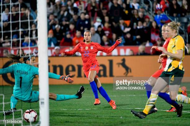 US forward Mallory Pugh watches her shot pass through the legs of Australia goalkeeper Lydia Williams during the women's international friendly...