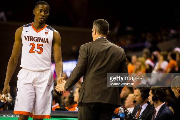 Forward Mamadi Diakite of the University of Virginia Cavalier shakes Head Coach Tony Bennett hand as he is benched in the last minutes of a game...