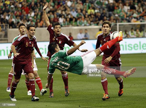 Forward Marcos Fabian of Mexico puts in a shot on goal in the first half against Venezuela during the international friendly between Mexico and...