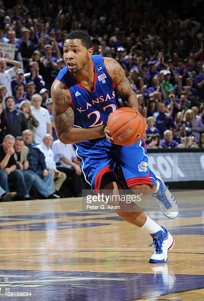 Forward Marcus Morris of the Kansas Jayhawks drives into the lane against the Kansas State Wildcats during the first half on February 14 2011 at...
