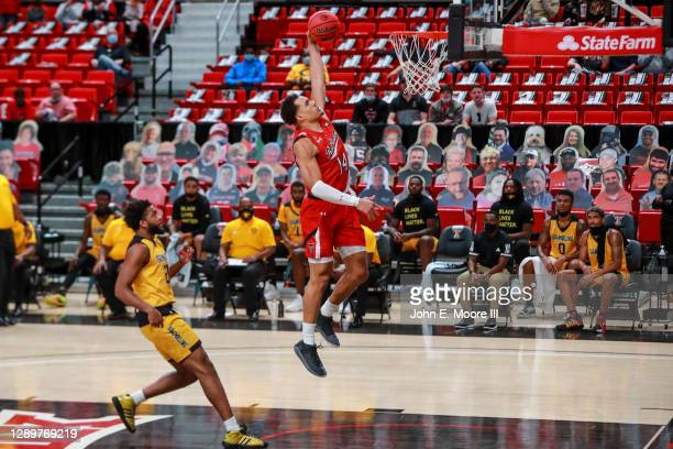 Forward Marcus Santos-Silva of the Texas Tech Red Raiders dunks the ball during the first half of the college basketball game against the Grambling...