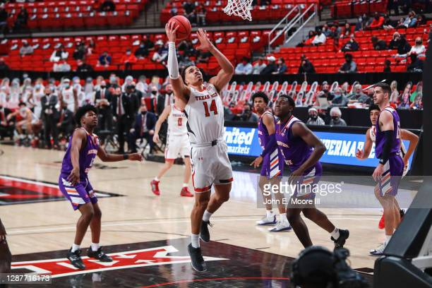 Forward Marcus Santos-Silva of the Texas Tech Red Raiders shoots a layup during the first half of the college basketball game against the...