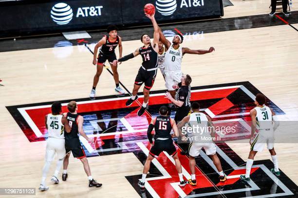 Forward Marcus Santos-Silva of the Texas Tech Red Raiders wins the tip-off against forward Flo Thamba of the Baylor Bears during the first half of...