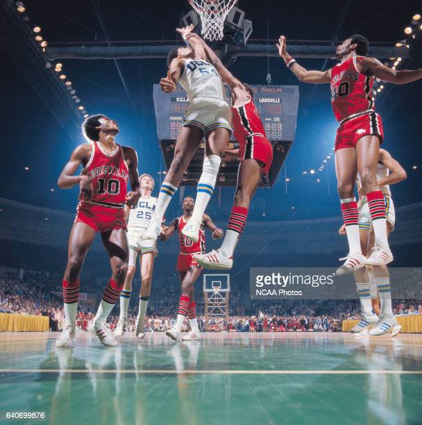 UCLA forward Marques Johnson and Louisville center William Bunton during the NCAA Photos via Getty Imagess via Getty Images Men's National Basketball...