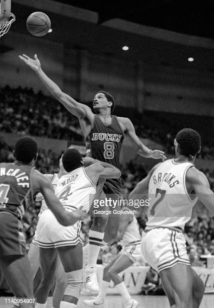 Forward Marques Johnson of the Milwaukee Bucks reaches for the basketball as teammate Sidney Moncrief and Al Wood and Michael Brooks of the San Diego...
