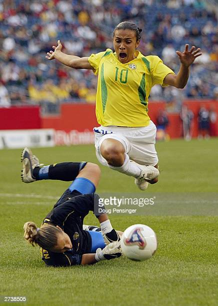 Forward Marta of Brazil flies through the air after being fouled by goalkeeper Sofia Lundgren of Sweden during the 2002 FIFA Women's World Cup...